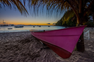 Caribbean Martinique beach sunset beside traditional fishing boat