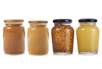 Bottles of Mustard on white background