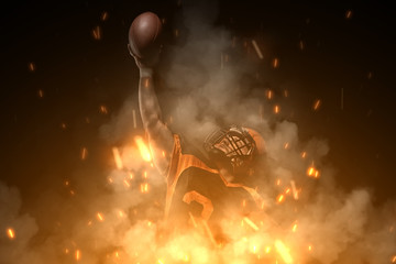 American football player on dark background in smoke and sparks in black and orange outfit.
