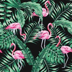 Wall Mural - Green tropical leaves and pink flamingo seamless pattern black background