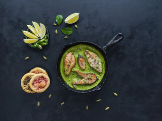 Green curry dish. Fish in spicy green curry.