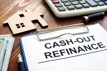 Cash out refinance documents and model of house.