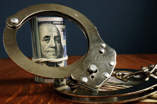 Penalty or bail bond concept. Money and handcuffs.