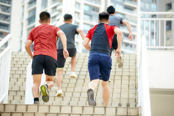 young asian athletes running up steps