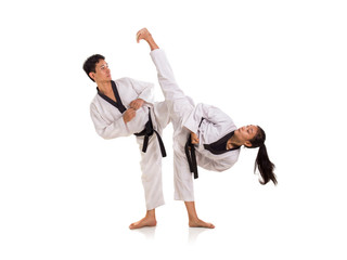 Young male and female taekwondo masters sparring session