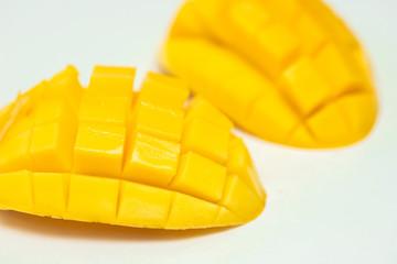 sliced mango on white background