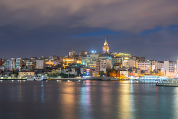 Wall Mural - Galata Tower at night with Istanbul city in Istanbul, Turkey