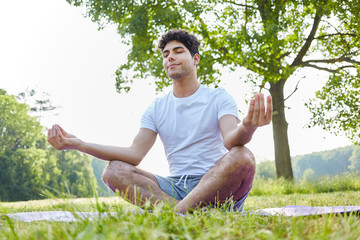 Young man making breathing yoga exercise