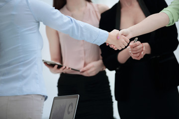 close up.handshake of business partners on background of employees