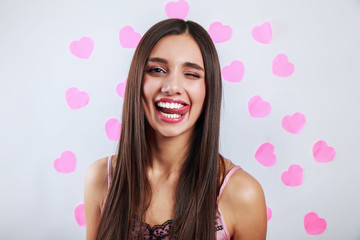 Beautiful brunette woman smiling . Expressive facial expressions. Valentines day love concept