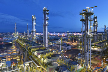industrial plant refinery at night - production and processing of crude oil