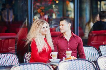 Beautiful romantic couple in Parisian outdoor cafe