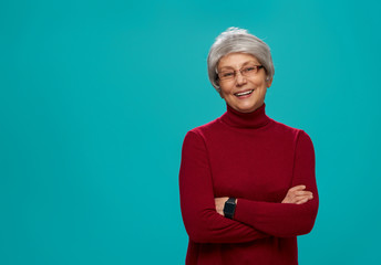 senior woman on teal background