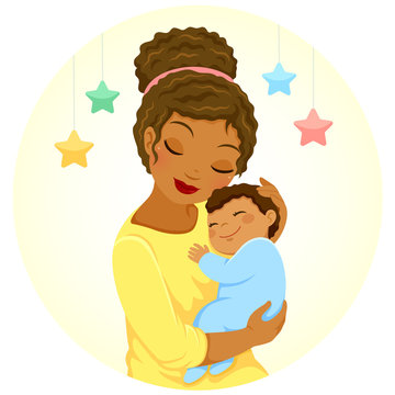 Young mother of black ethnicity hugging a smiling baby boy