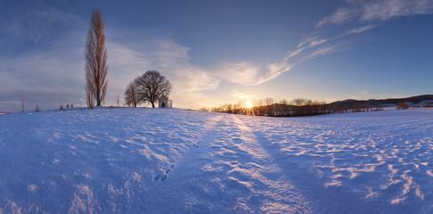 Winter field witn chapel - panorama rural landscape