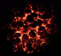 Poster Firewood texture Glowing Hot Charcoal Briquettes on garden grill, close-Up, Top View