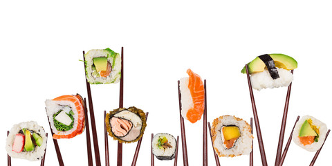 Traditional japanese sushi pieces placed between chopsticks, separated on white background. Very high resolution image.
