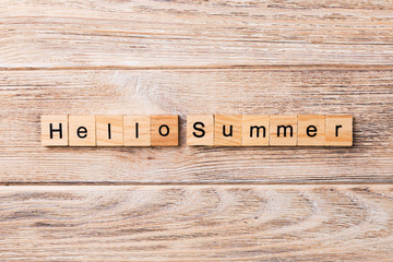 Hello Summer word written on wood block. Hello Summer text on wooden table for your desing, concept