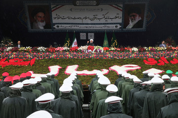 Iran's President Hassan Rouhani speaks during a ceremony to mark the 40th anniversary of the Islamic Revolution in Tehran