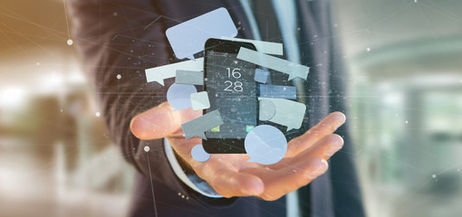 Businessman holding a Messages bubbles surrounding a smartphone 3d rendering