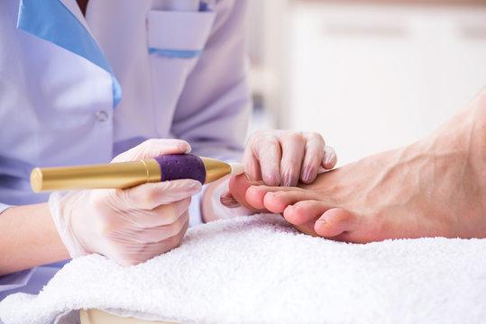 Podiatrist treating feet during procedure