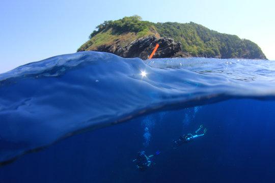 Scuba diving beside tropical island