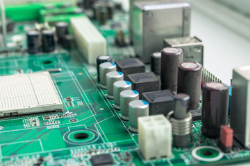Computer motherboard without a processor. Green chip ready-to-assemble