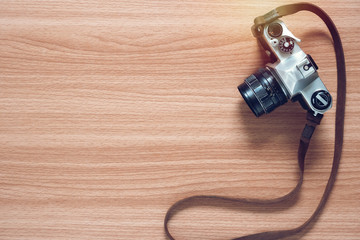 Vintage film camera on wooden table background