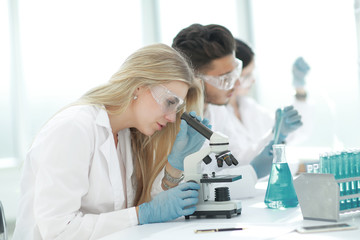close up.female scientist working in a modern laboratory