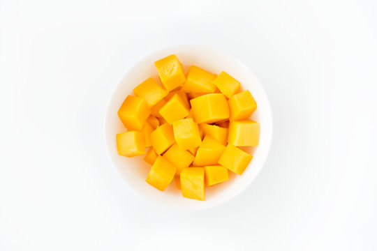 Mango Cubes in a Bowl Isolated over White