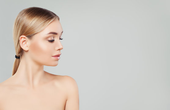 Beautiful blonde woman face, female profile on white background. Facial treatment, skin care and cosmetology concept