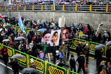Iranian people gather during a ceremony to mark the 40th anniversary of the Islamic Revolution in Tehran