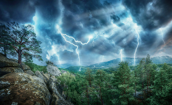 Lightning thunderstorm flash and sun lights in the mountains. Concept on topic weather, cataclysms (hurricane, Typhoon, tornado, storm)