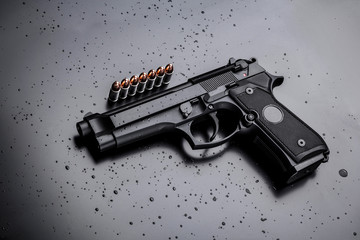 black modern gun on black background. 9mm pistol gun