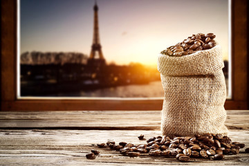 Coffee and Paris landscape. Free space for your decoration. Sunset time.