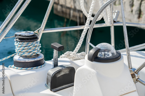The deck of the yacht in a sunny day  Steering gear of the yacht