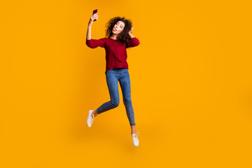 Full length body size view of nice lovely attractive cheerful funny funky comic playful slim thin fit wavy-haired lady taking making selfie having fun isolated on bright vivid shine orange background