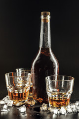 Glass of the whiskey and a square decanter