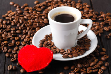Cup with coffee and shape of heart