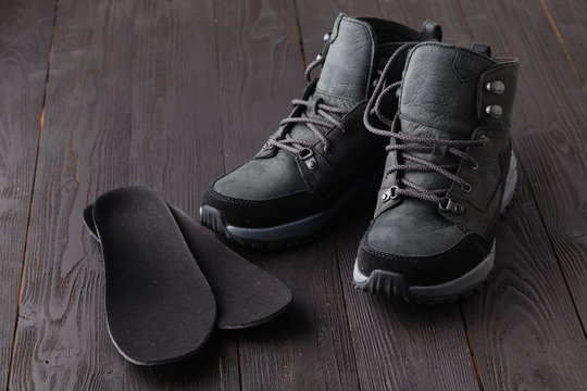 Warm shoes and orthopedic insoles. Winter background, footwear