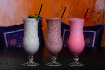 Three Indian healthy coctails  - wthite, pink and coffe with yogurt and rice