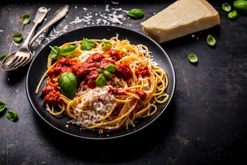 delicious appetizing classic spaghetti pasta with tomato sauce, parmesan Wall mural