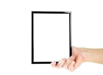 Hand holding black photo frame. Close up. Isolated on white background