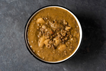 lentil stew in a white ceramic bowl