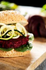 beet burger sandwich on a table.