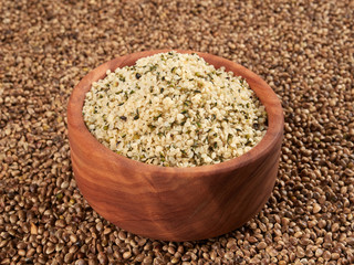 Bowl of shelled hemp seeds. Dietary supplement rich in protein and fibre.