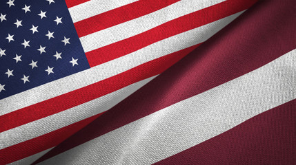 United States and Latvia two flags textile cloth, fabric texture