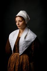 Medieval maid posing in studio