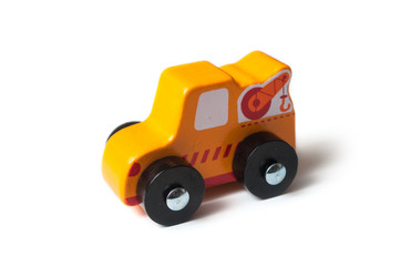 closeup of miniature wooden tow truck on white background - concept help on the road