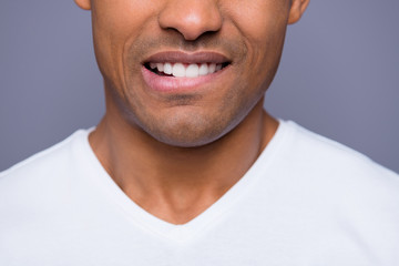Close-up cropped portrait of his he nice handsome attractive well-groomed content guy wearing white shirt beaming teeth isolated over gray violet pastel background